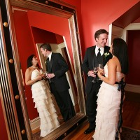 Bride and Groom reflected in a mirror