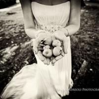 Creative Bridal Session black and white photograph with bride holding 5 apples in a mother earth style pose