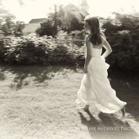 Creative Bridal Session black and white photograph with bride running through her childhood backyard