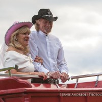 Creative Bridal Session with close up moment of Bride and Groom in a Clydesdale horse drawn red wagon