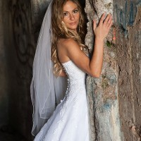 Creative Bridal Session with the Bride in a 3/4 length pose leaning on a door frame