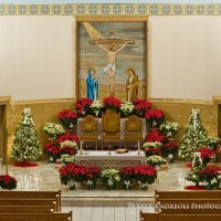 Prince of Peace Church, Old Forge, PA. Formerly Saint Mary's Church alter view decorated for Christmas with manger and poinsettias